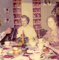 Mary (Kearns) Dunn at breakfast (center)